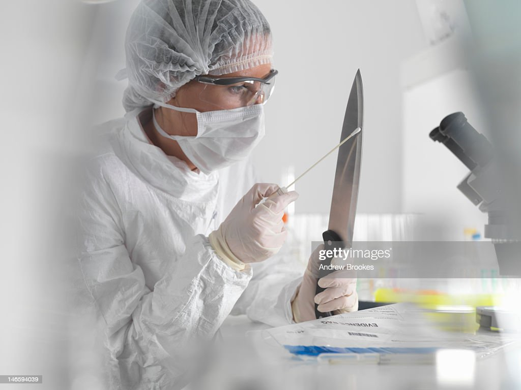 Forensic scientist with evidence in lab
