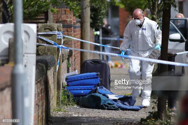 A forensic scientist works at the scene in Cranbourne Rd ChorltoncumHardy where exRoyal Navy officer Michael Samwell was fatally injured as he...