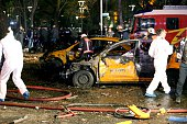 Forensic services and firemen work around burnt out taxi vehicles after a blast in Ankara on March 13 2016 An explosion ripped through a busy square...