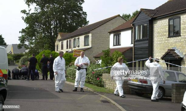 A forensic team outside the scene of a triple shooting at a house in the Broadoak culdesac in Horton near Ilminster Somerset The mother and daughter...