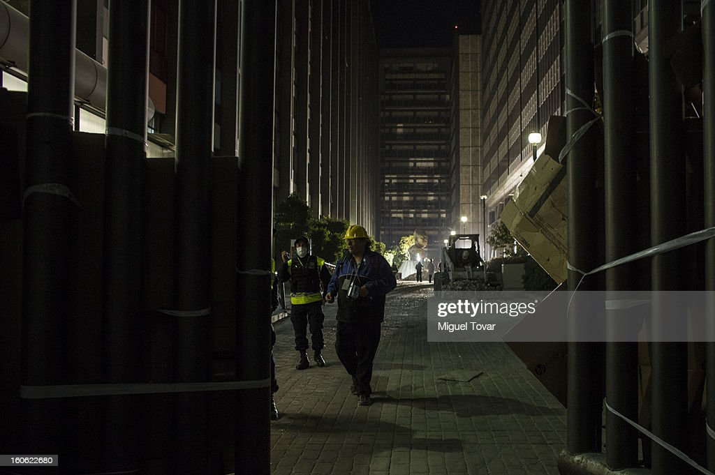 Forensic workers and authorities investigate the administrative building of PEMEX on February 03, 2013 in Mexico City, Mexico. Authorities investigate a blast that killed at least 34 people at the state-owned companys headquarters in Mexico City.