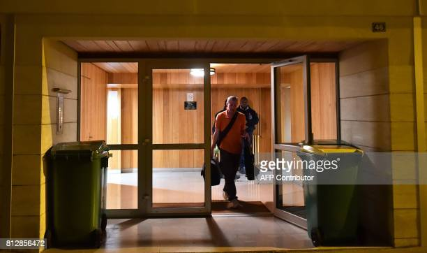 Forensics and police officers leave the house of late French magistrate JeanMichel Lambert who was found dead at his home on July 11 in Le Mans...