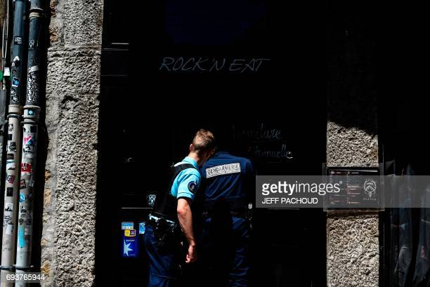 Forensics enter a bar in Lyon on June 8 2017 to probe the walls of the cellar and search for the body of Nathalie Guyot who disappeared 35 years ago...
