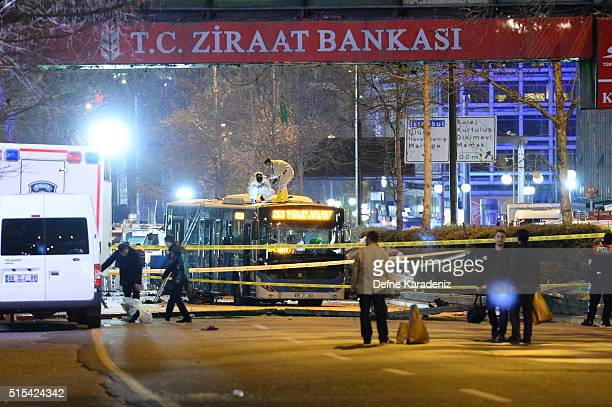 Forensics investigate the scene of an explosion on March 13 2016 in Ankara Turkey The Ankara governor's office has reported that at least 32 people...
