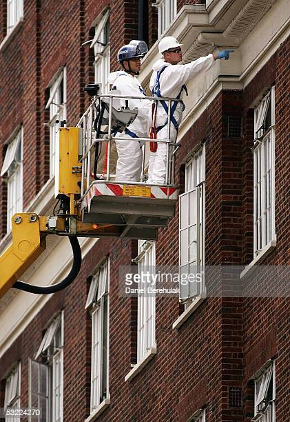 Forensics mark the wall with chalk after examining the facade in Tavistock Square the sight of the bus bomb blast July 11 2005 London England A...