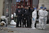 Forensics of the French police are at work outside a building in the northern Paris suburb of SaintDenis on November 19 where French Police special...