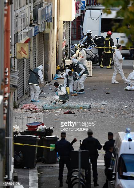 Forensics of the French police work outside a building next to the remains of a human head in the northern Paris suburb of SaintDenis on November 18...