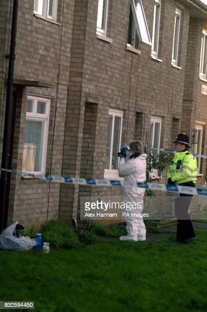 A forensics officer and a police officer attend to the aftermath of a tragic blaze in Dupont Gardens New Parks Leicester Press Association Photo...