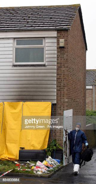 A forensics officer conducts an examination of a house in Milfoil Drive Eastbourne East Sussex where two children were found dead following a house...