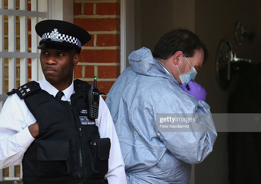 A forensics officer enters a house in New Malden where the bodies of three children were found on April 23, 2014 in south London, England. Police say that a 42-year-old woman has been arrested after the bodies of three children were found at a property last night.