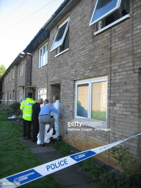 Forensics officers attend to the aftermath of a tragic blaze in Dupont Gardens New Parks Leicester Press Association Photo Picture Date Saturday...