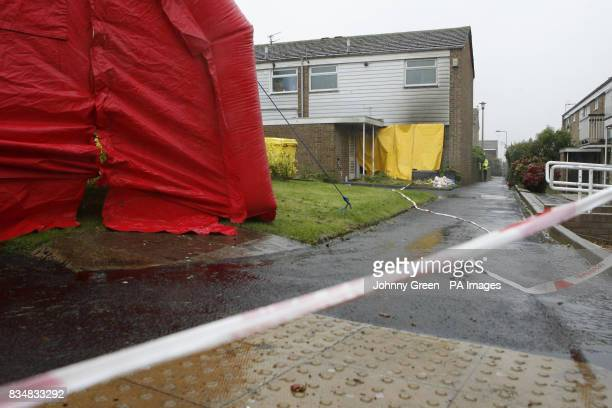 Forensics officers conduct a full examination of a house in Milfoil Drive Eastbourne East Sussex where two children were found dead following a house...