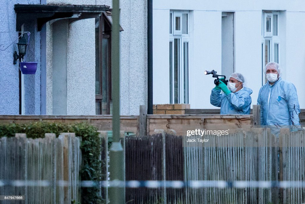 Forensics officers investigate a property on Cavendish Road during a raid in connection with the terror attack at Parsons Green station on September 16, 2017 in Sunbury, England. An 18-year-old man has been arrested in Dover in connection with yesterday's terror attack on Parsons Green station in which 30 people were injured. The UK terror threat level has been raised to 'critical'.