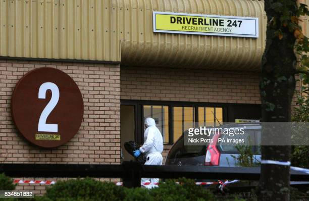 Forensics Officers search Driverline 247 on New Road at New Inn Pontypool South Wales