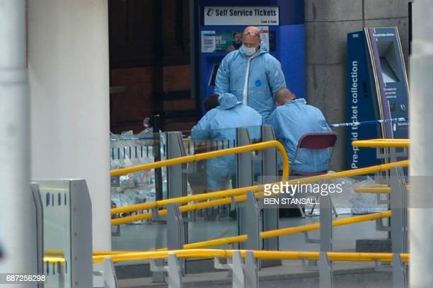 TOPSHOT Forensics officers work at the scene at Manchester Victoria station in central Manchester northwest England on May 23 2017 following a deadly...