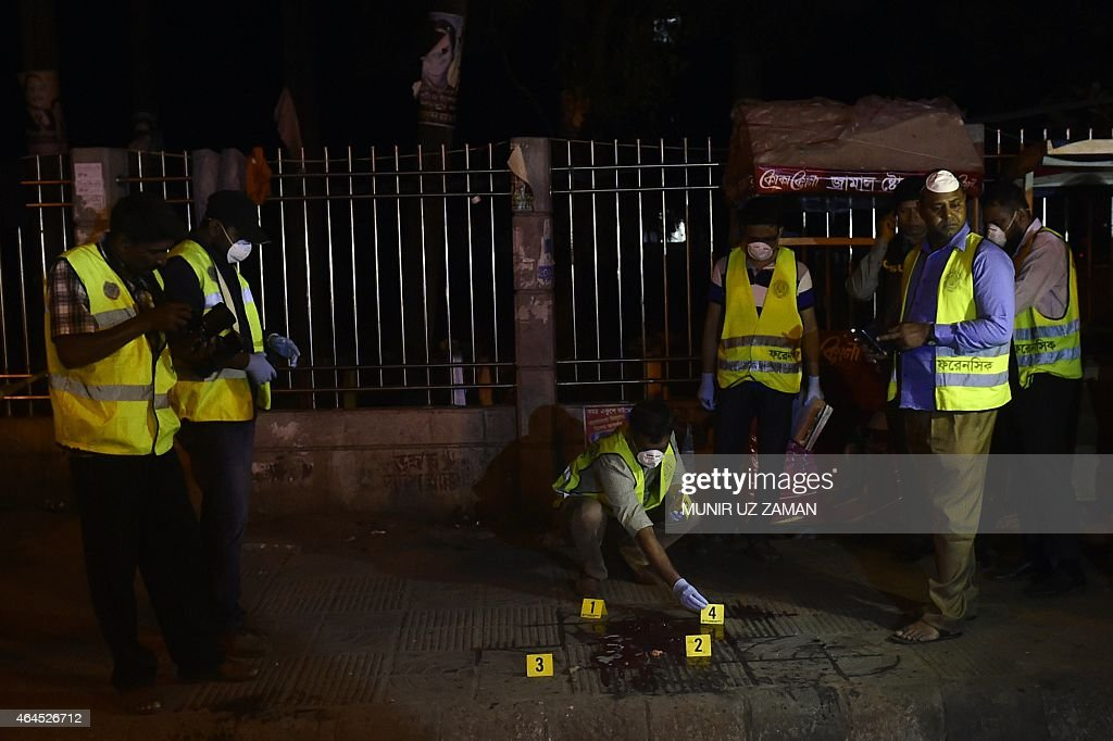 Forensics police investigates the site where US blogger of Bangladeshi origin hacked to death in Dhaka on February 27 2015 Avijit Roy founder of...