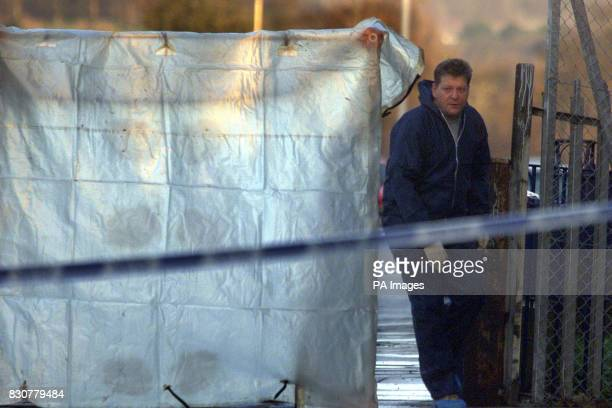 Forensics work at the scene of the shooting on the Forthriver road North Belfast where former police agent William Stobie an exUlster Defence...