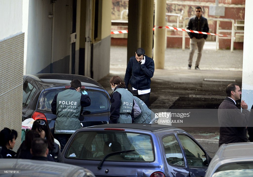 Forensics work on the site where a man was killed in a shoot-out north of Marseille on February 27, 2013. The victim, known for drug trafficking and who was born in 1989, was recently released from prison, said a source close to the investigation.