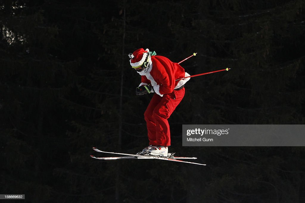 A forerunner dressed as Santa Claus races down the course during the Audi FIS Freestyle Skiing World Cup Skier Cross race on December 23, 2012 in Innichen, San Candido, Italy.