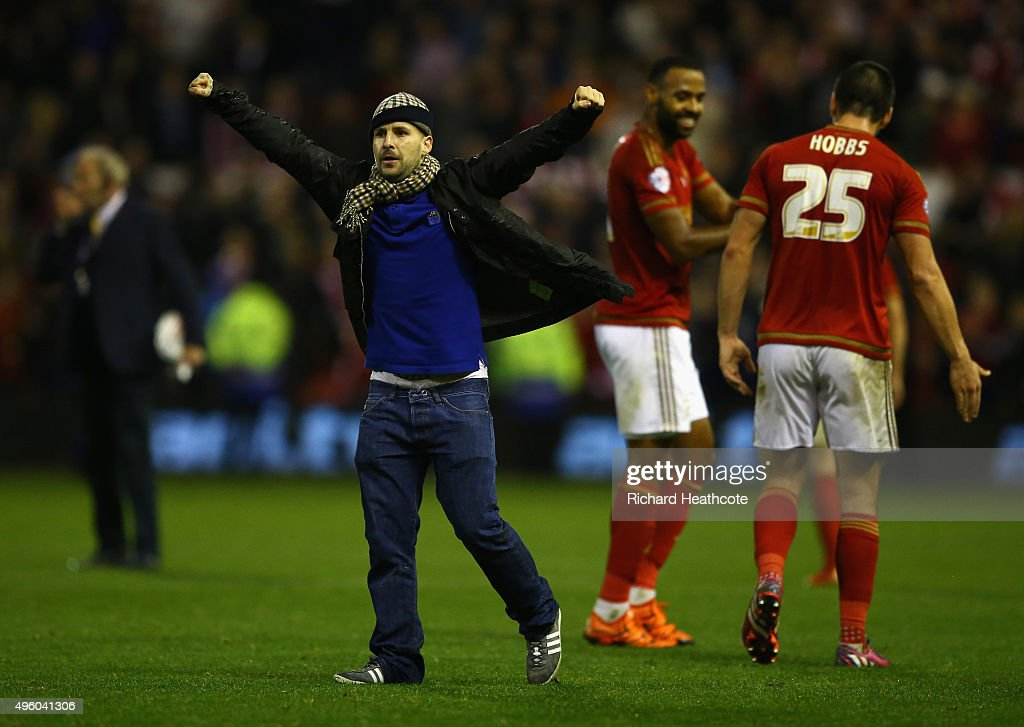 Forest fans invade the pitch at the final whistle during the Sky Bet Championship match between Nottingham Forest and Derby County at City Ground on November 6, 2015 in Nottingham, England.