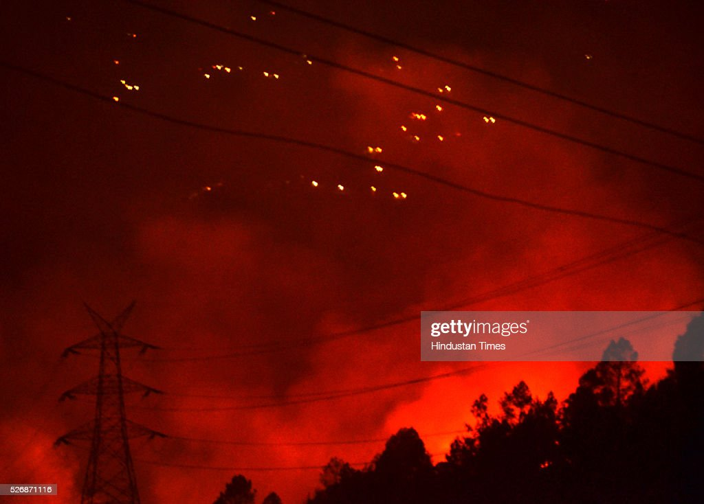 Forest fire approaching very close to the high tension electricity poles near Buakhal, on May 1, 2016 in Uttarakhand, India. Two Indian Air Force (IAF) choppers began spraying water over the burning forests in Uttarakhand on Sunday morning. Major forest fires raged across Uttarakhand even as two Indian Air Force (IAF) choppers have begun spraying water to extinguish the flames. Presently, some 5,000 workers -- including 3,000 daily wagers -- are engaged in putting out the fire. More than 2300 hectares of forest have been gutted in the fire since it was first reported in February this year. Dry winters and soaring temperatures are blamed for the fire that has affected all 13 districts of the state.