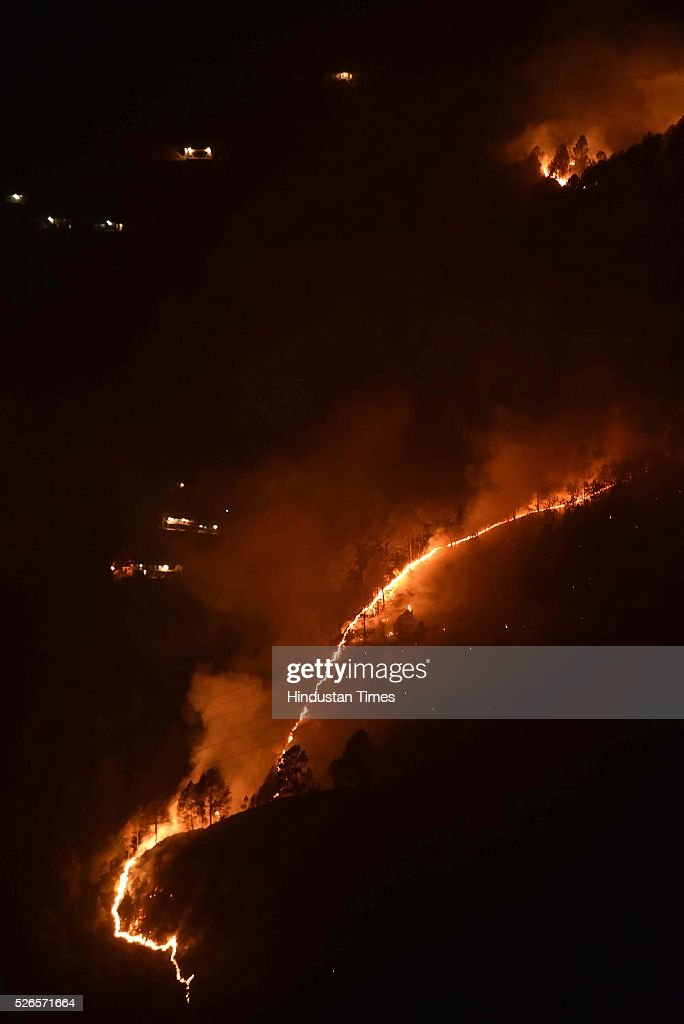 Forest fire at Pauri Garhwal District, on April 30, 2016 in Uttarakhand, India. Three National Disaster Response Force deployed three teams on Saturday to control forest fires in Uttarakhand that have destroyed nearly 1900 hectares of forest land in 13 districts since February. On Friday night, scores of villagers had rushed outside their homes to prevent the advancing blaze from engulfing their houses, even as government rescue teams struggled to contain the fire. 1,900 hectare of forest in five districts have been affected in Uttarakhand fire so far.