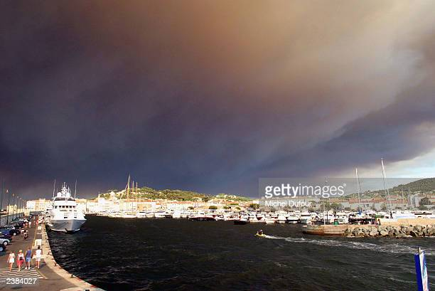 Forest fires fanned by hot winds continue to burn on August 6 2003 St Tropez France Meteo France said it expects at least another week of abnormally...