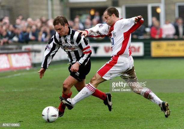 Forest Green Rovers captain Martin Foster is challenged by Exeter's Martin Thomas during their AXA Sponsored FA Challenge Cup First Round match at...