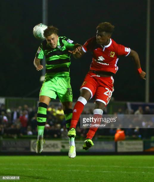 Forest Green Rovers' Charlie Cooper vies for the ball with MK Dons' Aaron Tshibola during the EFL Cup football match between Forest Green Rovers and...