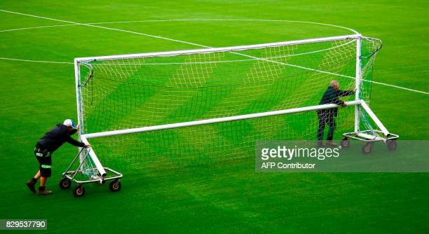 Forest Green Rovers groundsmen prepare the team's organic football pitch ahead of the EFL Cup football match between Forest Green Rovers and MK Dons...