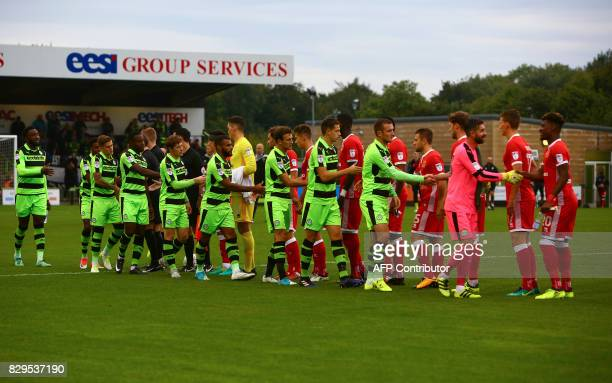 Forest Green Rovers players greet MK Dons' players ahead of the EFL Cup football match between Forest Green Rovers and MK Dons at The New Lawn...