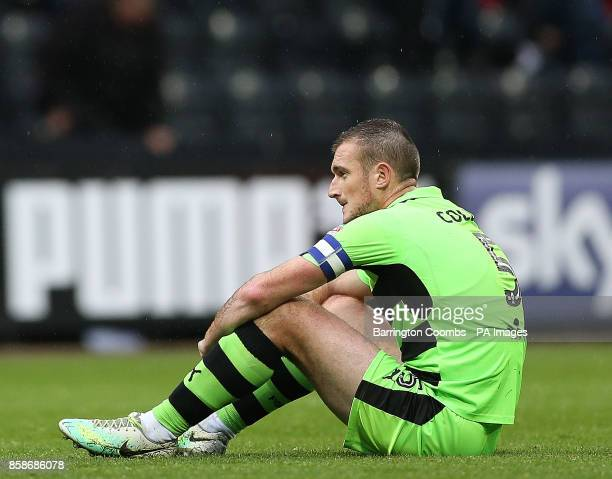 Forest Green Rovers's captain Lee Collins looks dejected at the end the match at Meadow Lane Nottingham