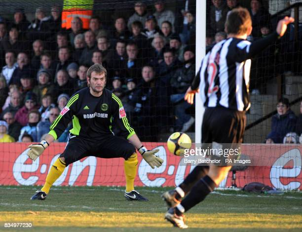 Forest Green's Alex Lawless scores their second goal of the game past Derby County goalkeeper Roy Carroll during the FA Cup Third Round match at New...