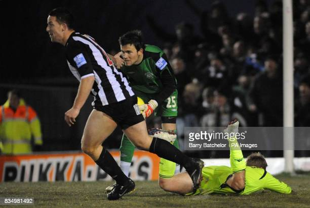 Forest Green's Darren Jones and goal keeper Terry Burton react as Derby's Kris Commons lies on the ground after being fowled in the penalty area...
