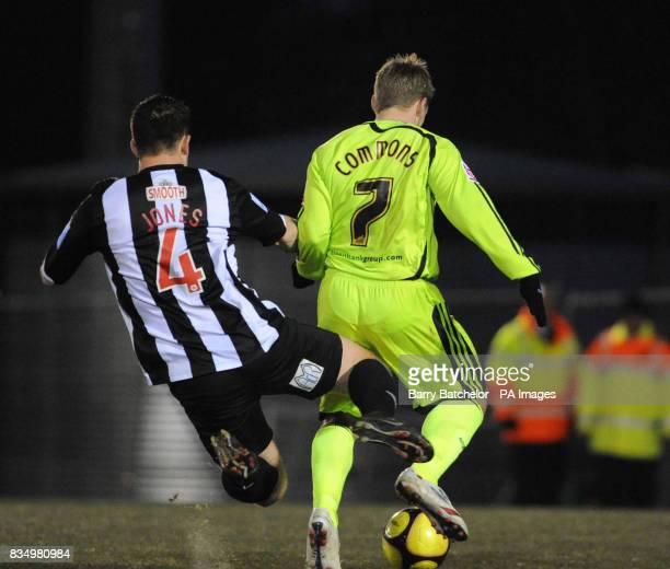 Forest Green's Darren Jones challenges Derby's Kris Commons in the penalty area which resulted in a red card for Jones and a successful penalty kick...