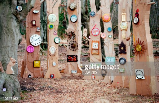Forest of cardboard trees with clocks