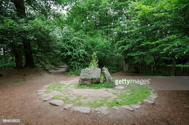 Forest of Paimpont mythical forest of Broceliande August 2014 Merlin's tomb This is where Merlin was imprisoned deliberately and forever by the...