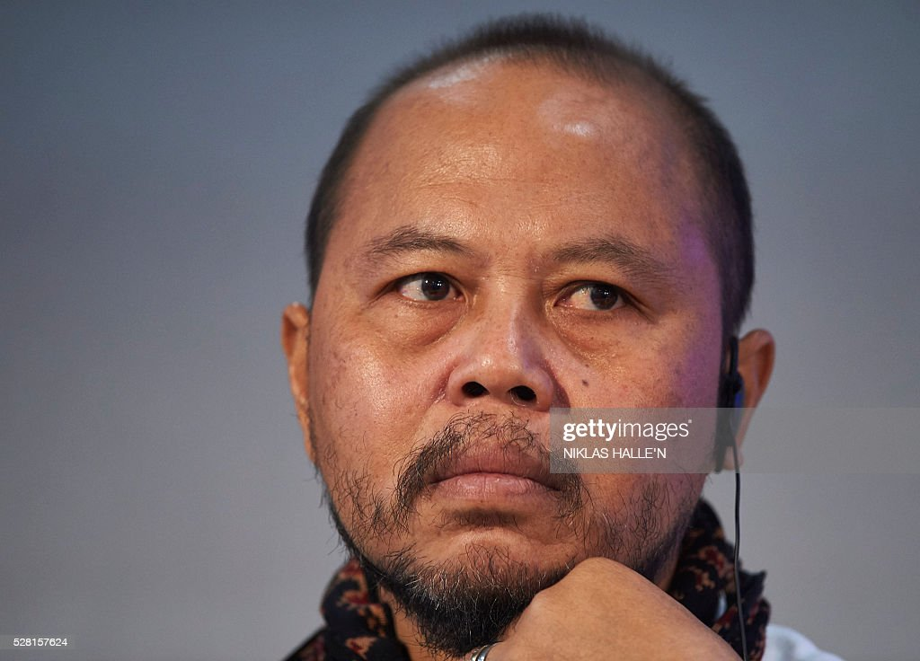 Forest Peoples Programme's Indegineous representative from Indonesia, Yafet Leonard Franky, listens during the Forest People Programme press conference at the Queen Elizabeth conference centre in central London on May 4, 2016. Indigenous and civil society leaders from Indonesia, Peru, Colombia and Liberia gathered in London Wednesday to urge a boycott of firms that commit human rights violations and land seizures to cultivate palm oil. The EU is the third largest importer of palm oil, a key ingredient in many everyday goods, from biscuits to make-up. / AFP / NIKLAS HALLE'N
