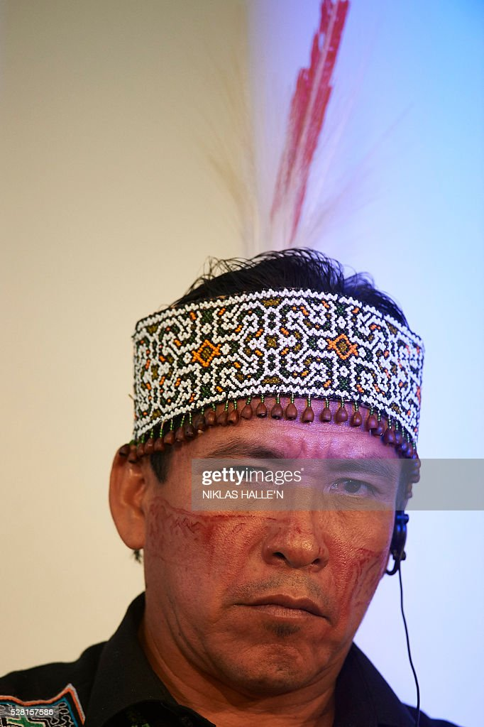 Forest Peoples Programme's Indegineous representative from Peru, Sedequ��as Ancon Chavez, listens during the Forest People Programme press conference at the Queen Elizabeth conference centre in central London on May 4, 2016. Indigenous and civil society leaders from Indonesia, Peru, Colombia and Liberia gathered in London Wednesday to urge a boycott of firms that commit human rights violations and land seizures to cultivate palm oil. The EU is the third largest importer of palm oil, a key ingredient in many everyday goods, from biscuits to make-up. / AFP / NIKLAS HALLE'N