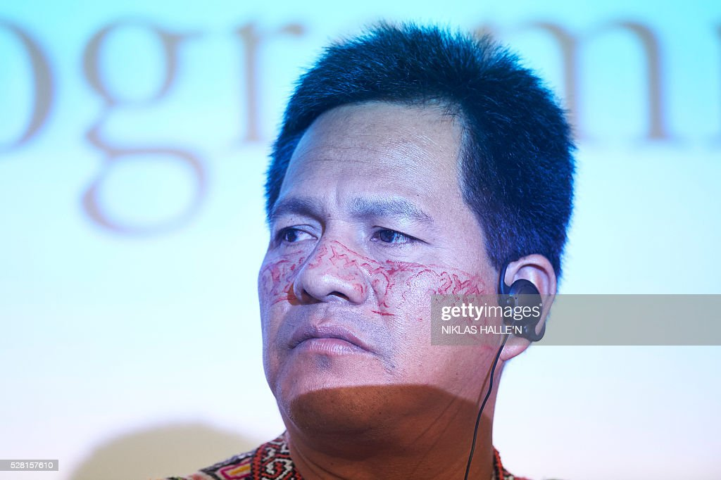 Forest Peoples Programme's Indegineous representative from Peru, Robert Guimaraes Vasquez, listens during the Forest People Programme press conference at the Queen Elizabeth conference centre in central London on May 4, 2016. Indigenous and civil society leaders from Indonesia, Peru, Colombia and Liberia gathered in London Wednesday to urge a boycott of firms that commit human rights violations and land seizures to cultivate palm oil. The EU is the third largest importer of palm oil, a key ingredient in many everyday goods, from biscuits to make-up. / AFP / NIKLAS HALLE'N