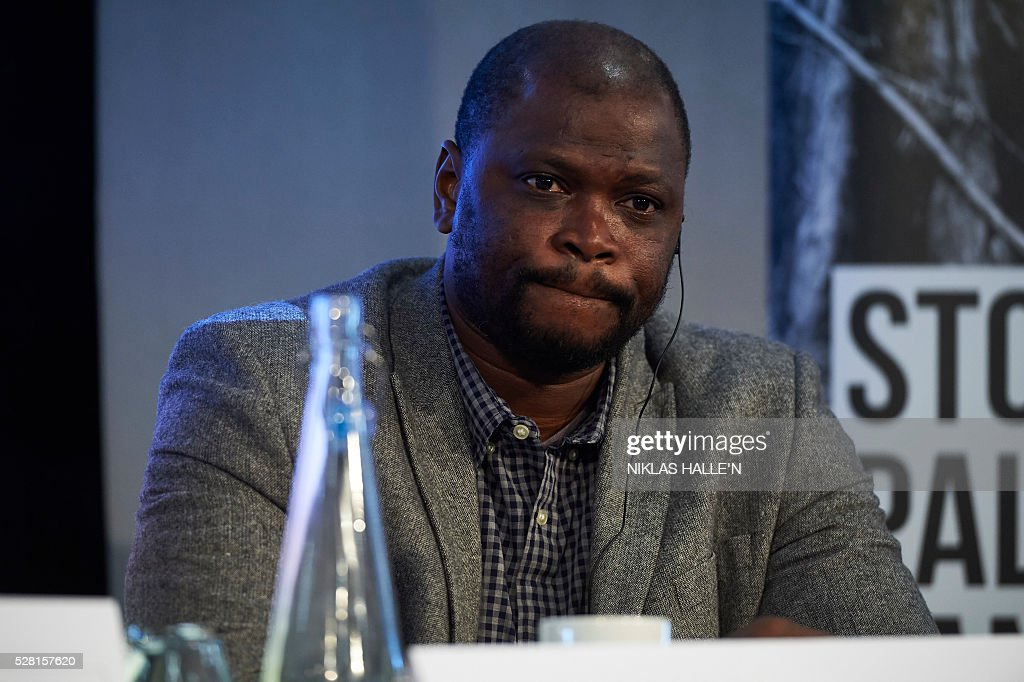 Forest Peoples Programme's representative from Liberia, Ali Diakty Kaba, listens during the Forest People Programme press conference at the Queen Elizabeth conference centre in central London on May 4, 2016. Indigenous and civil society leaders from Indonesia, Peru, Colombia and Liberia gathered in London Wednesday to urge a boycott of firms that commit human rights violations and land seizures to cultivate palm oil. The EU is the third largest importer of palm oil, a key ingredient in many everyday goods, from biscuits to make-up. / AFP / NIKLAS HALLE'N