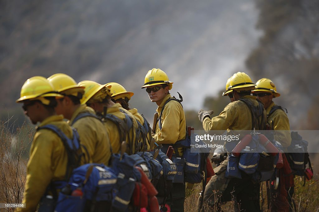 U.S. Forest Service firefighters watch for spots at the Williams fire in the Angeles National Forest on September 4, 2012 north of Glendora, California. The fire began late September 2, putting an early end to Labor Day weekend camping and hiking for vacationers, who were evacuated from the area as it spread to more than 4,000 acres in size. Officials project that it will take at least another week to establish a containment line around the fire which is burning in rugged and difficult to reach backcountry.