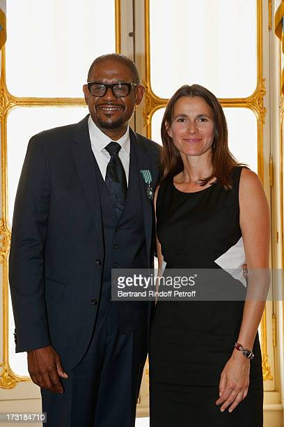 Forest Whitaker and Aurelie Filippetti attend the Forest Whitaker And Rossy De Palma 'Arts et des Lettres' decoration at Ministere de la Culture on...