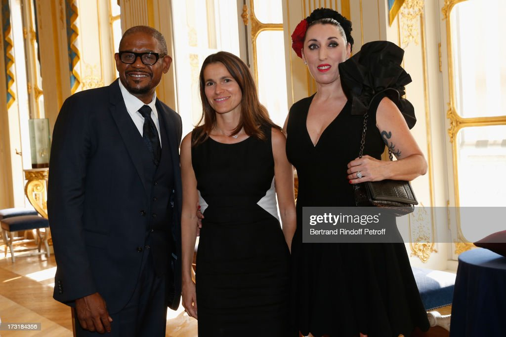 <a gi-track='captionPersonalityLinkClicked' href=/galleries/search?phrase=Forest+Whitaker&family=editorial&specificpeople=226590 ng-click='$event.stopPropagation()'>Forest Whitaker</a> (L) and Rossy De Palma (R) decorated by <a gi-track='captionPersonalityLinkClicked' href=/galleries/search?phrase=Aurelie+Filippetti&family=editorial&specificpeople=4273748 ng-click='$event.stopPropagation()'>Aurelie Filippetti</a> (C) at Ministere de la Culture on July 9, 2013 in Paris, France.