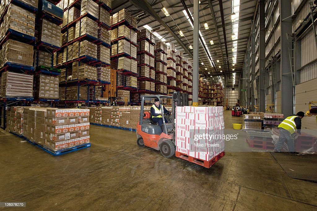 Fork lift machines in warehouse storage for breakfast cereal ingredients, Bedfordshire, UK : Stock Photo