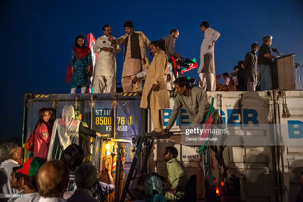 A fork lift raises party members up to a stage as people wait for Imran Khan, chairman of the Pakistan Tehrik e Insaf (PTI) party, to arrive for an election campaign rally on May 07, 2013 in Lahore, Pakistan. PTI chairman Imran Khan was injured at the previous rally in Lahore today after falling while departing the stage. Pakistan's parliamentary elections are due to be held on May 11. Imran Khan of Pakistan Tehrik e Insaf (PTI) and Nawaz Sharif of the Pakistan Muslim League-N (PMLN) have been campaigning hard in the last weeks before polling.