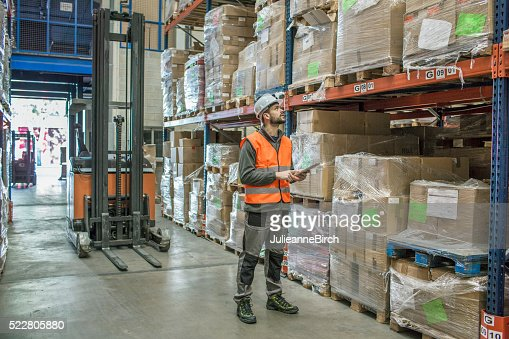 Fork lift truck driver and digital tablet
