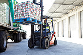 Fork lift truck loading a lorry
