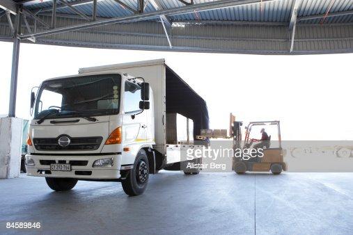 Fork lift truck loading lorry