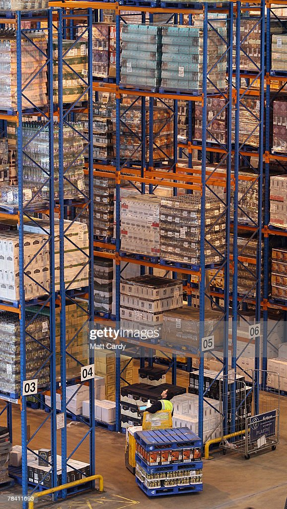 A fork lift truck moves about the racks at the giant distribution centre in Avonmouth on December 12 2007 near Bristol, England. The giant warehouse, owned by Constellation Europe, is currently packed full of pallets of alcohol to be dispatched - with 90per cent destined for the UK - which means a lorry leaving every seven minutes, 24 hours a day, to keep up with demand.
